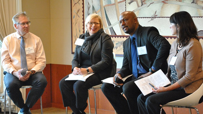 Panelists take questions at the October 30, 2019, peer learning exchange on mixed-income housing policies. From left to right: Bill Neuendorf, City of Edina; Julie Wischnack, City of Minnetonka; Eric Johnson, City of Bloomington; and moderator Cathy Capone Bennett, Urban Land Institute Minnesota.