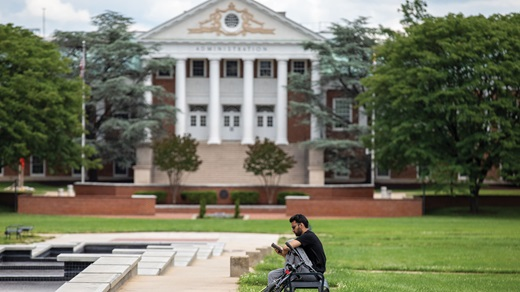 student sitting in an empty campus