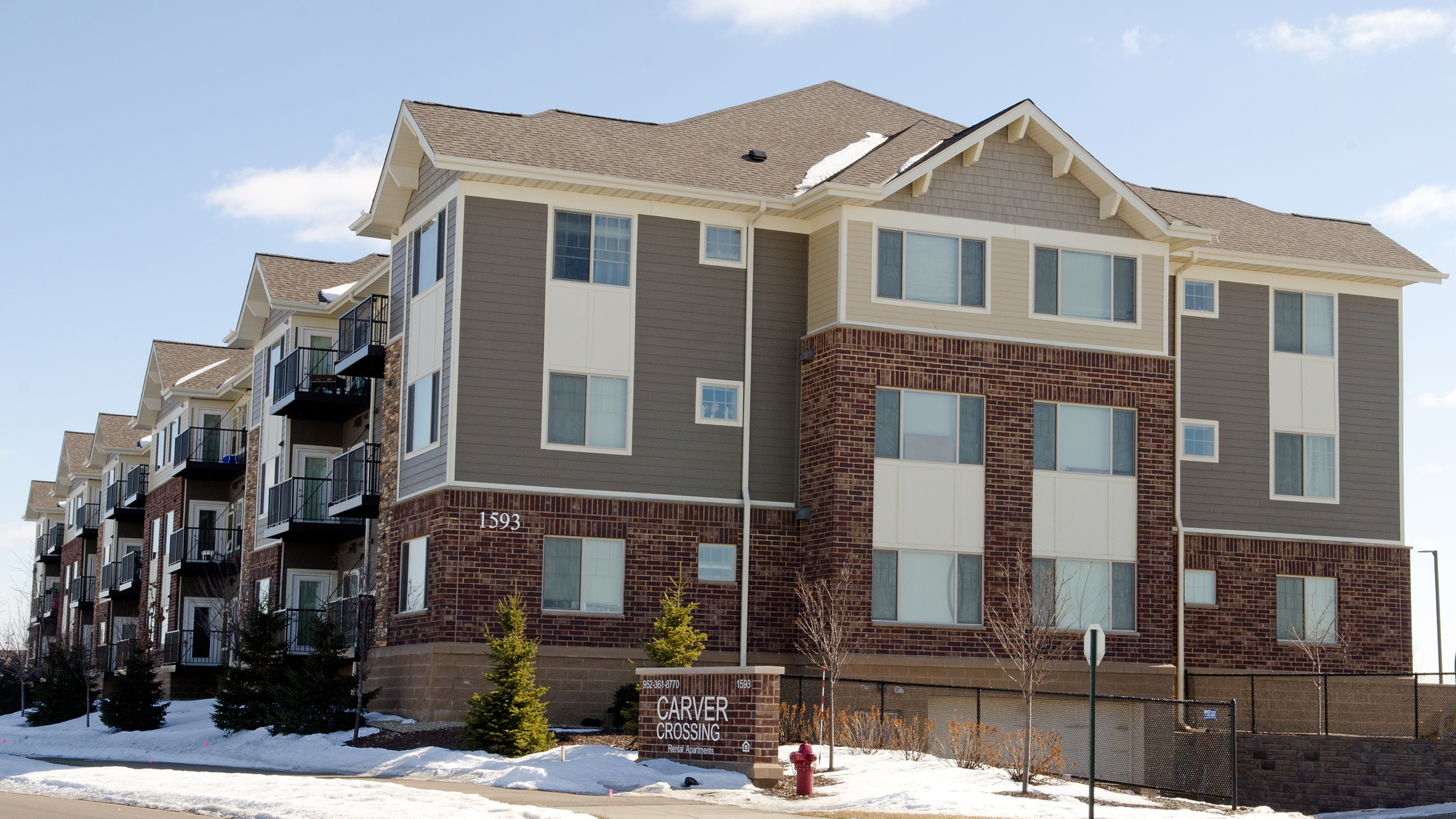 Once opposed by many neighbors, the Carver Crossing apartment complex in Carver, Minn., has become an accepted part of the community.