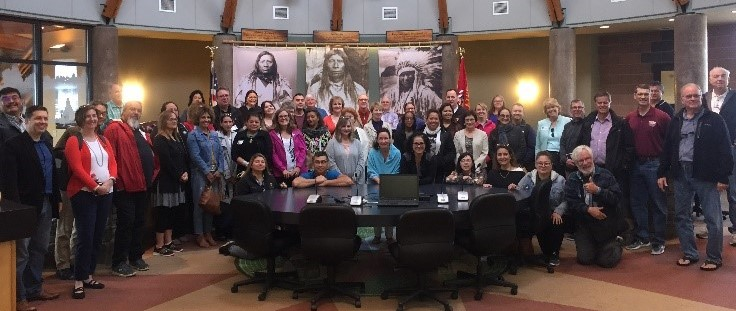 Group photo from the inaugural convening with Native American financial institutions (NAFIs)