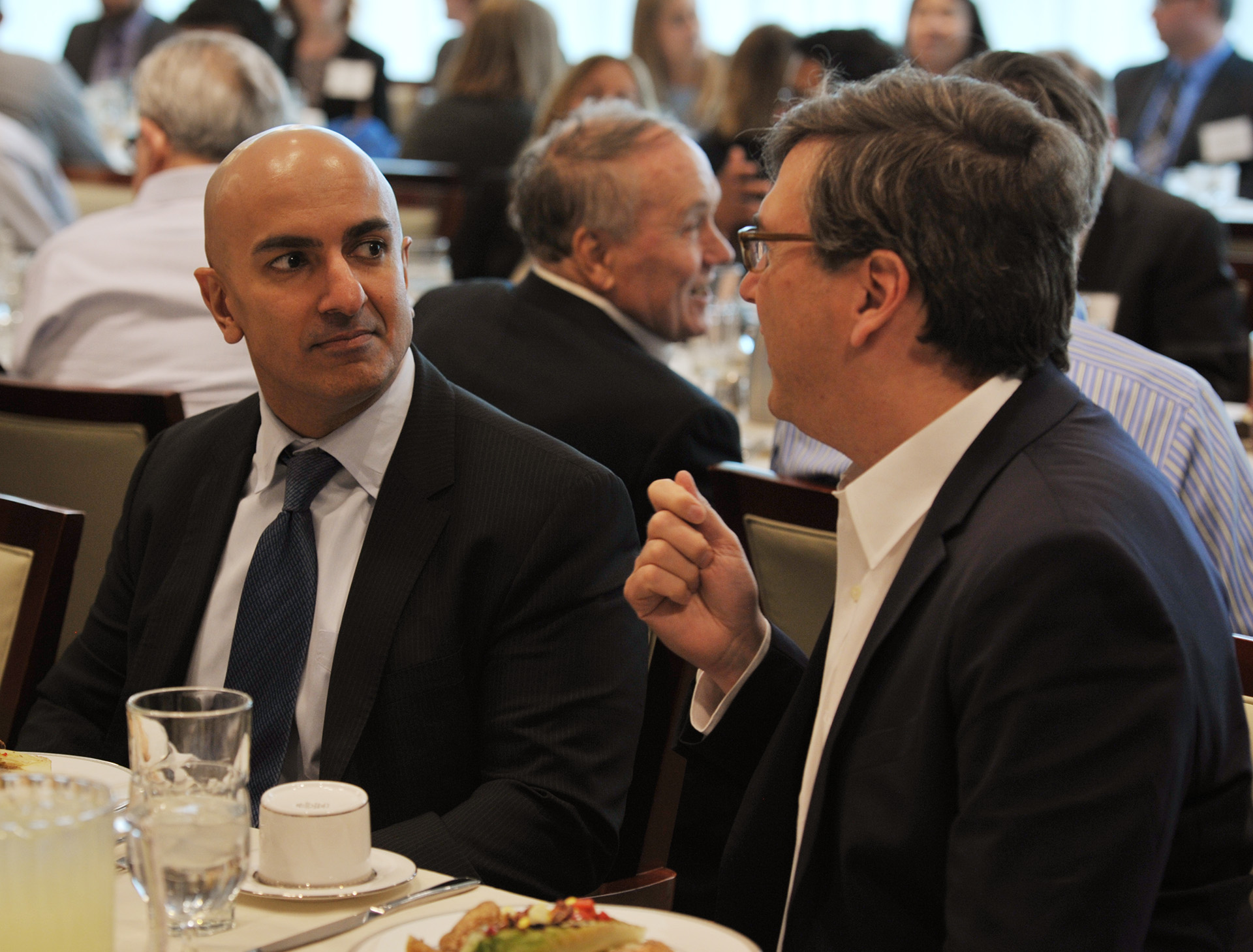 Kashkari and Furman speaking together at lunch