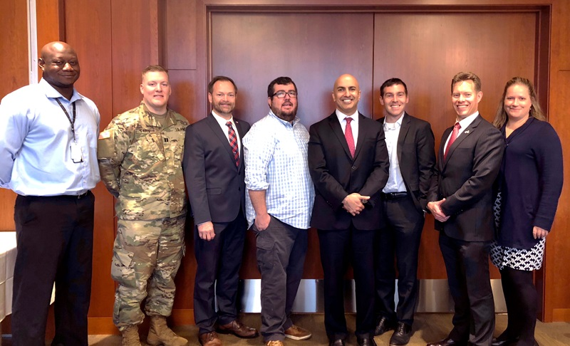 Photo of Neel Kashkari and veterans