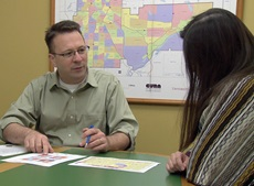 Jeff Matson, coordinator of the Community Geographic Information Systems program at the University of Minnesota's Center for Urban and Regional Affairs, meets with a representative from a client organization. (Photo by Chris Long)
