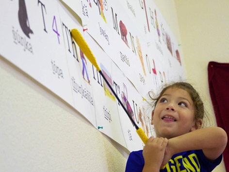 A child learns her letters at Lakota Immersion Childcare
