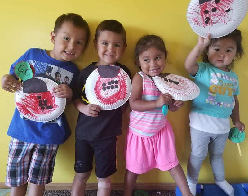ECD in Indian Country, preschoolers displaying their art, 2 column