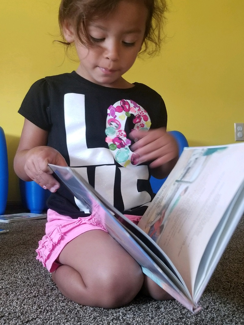 ECD in Indian Country, preschool girl reading, 2 column