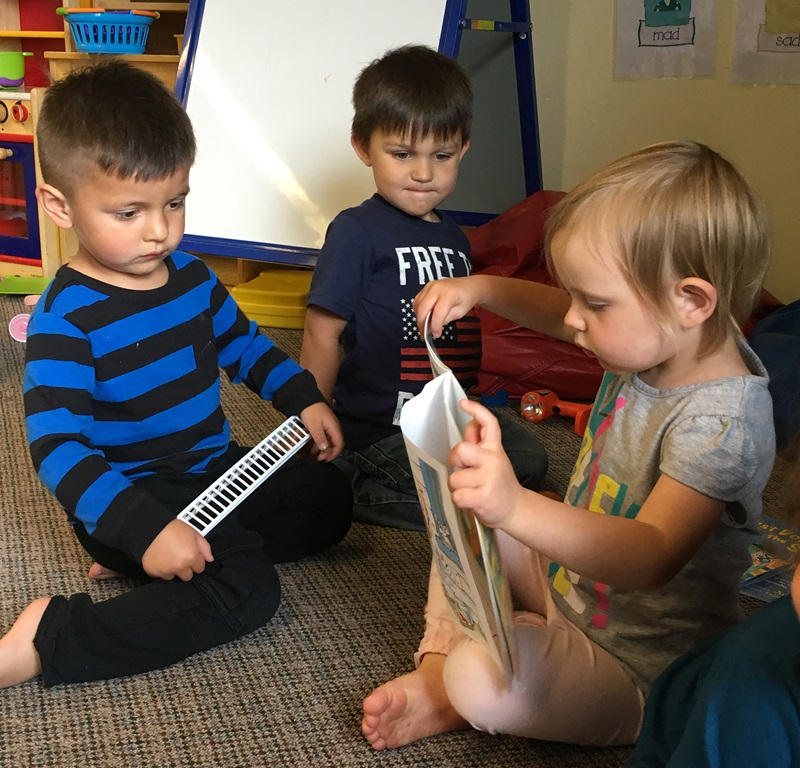 ECD in Indian Country, toddler reading, 2 column
