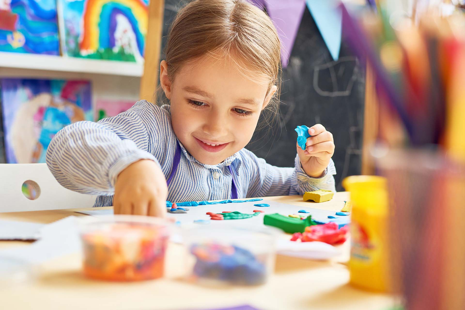 Pay for Success for ECD, preschool girl at art table