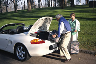 Photo: Couple packing car