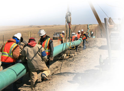 Construction crews under contract for WBI Energy lay a natural gas pipeline near Williston, N.D.