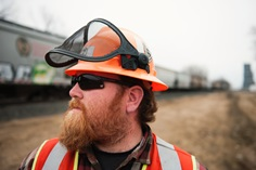 Canadian Pacific engineering employee Eric Lundon inspects a passing train at Wyndmere, N.D.