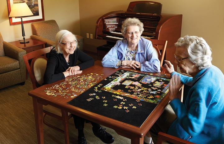 Verna Olson, Grace Neumann and Patricia Lysen socialize at Minnehaha Senior Living in Minneapolis.