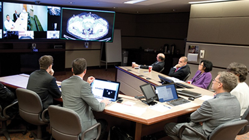 Mayo's eTumor Board members consult with providers onscreen about an oncology case through the subscriber-based Mayo Clinic Care Network.