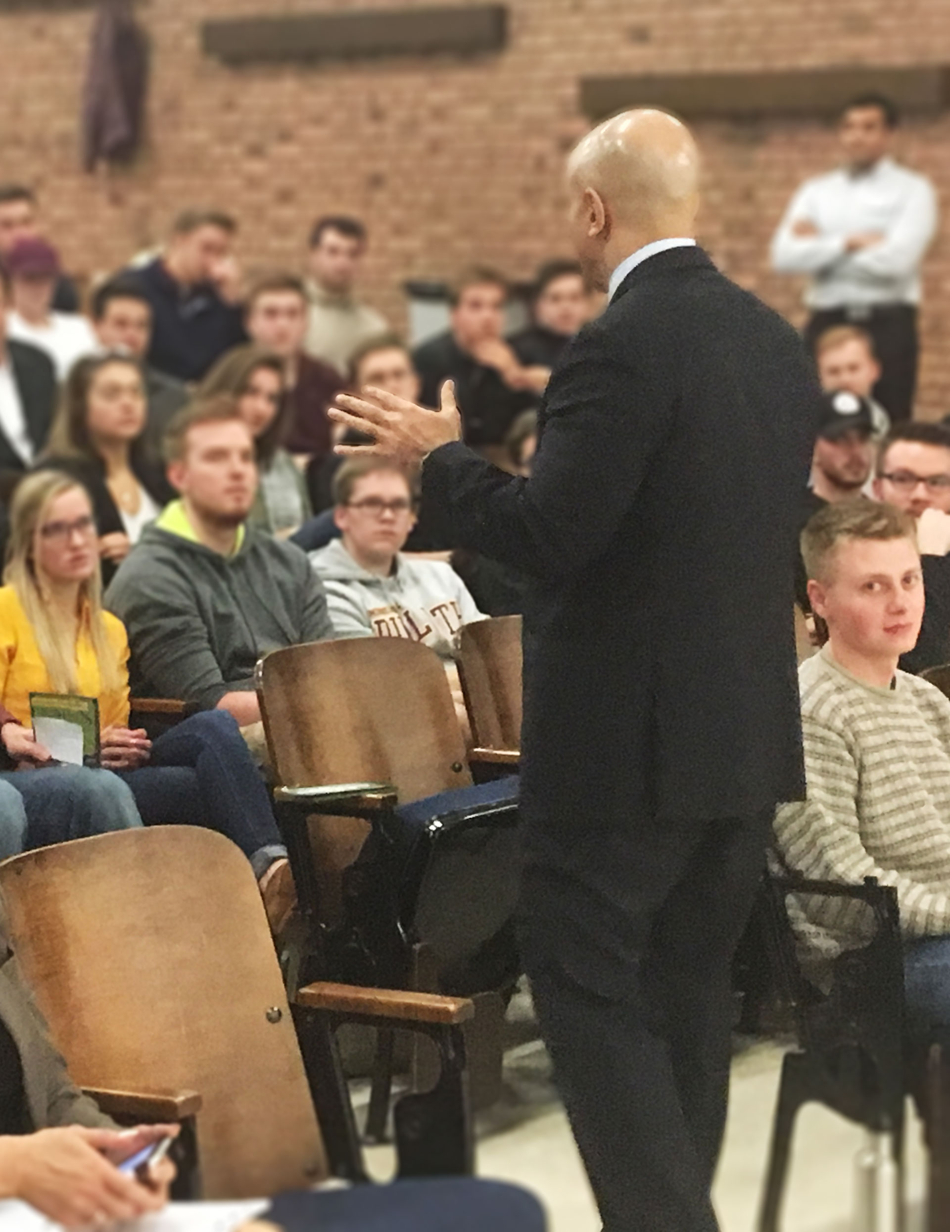 Neel Kashkari speaking to a lecture hall of students