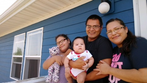 With the help of Lakota Funds, Kateri Edwards and Royce Gone bought their home last May. They're joined here with their children, Summer and Royce, Jr.