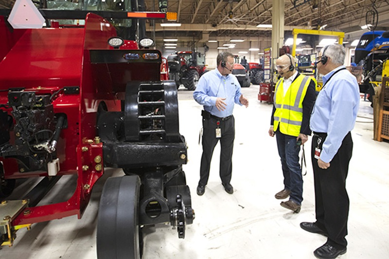 Photo of Neel touring a CNH Industrial plant